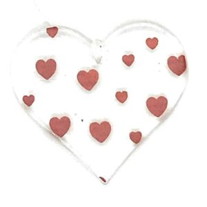 small glass heart with red hearts