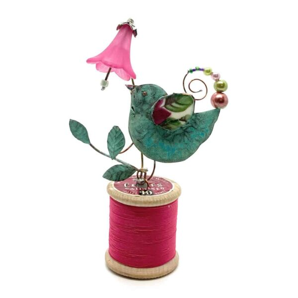 birdie and pink harebell on red bobbin assemblage